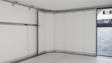 Portes de garage à déplacement latéral